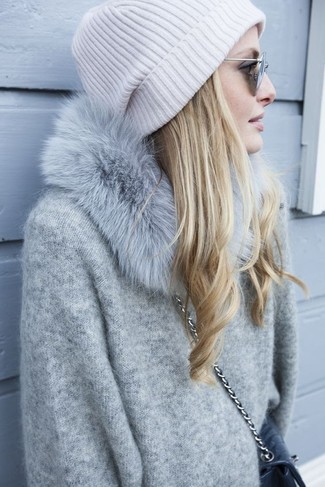 How to wear: grey oversized sweater, black quilted leather crossbody bag, white beanie, grey fur scarf