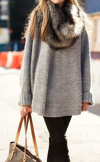 Show off your playful side in a grey oversized sweater and jeans.