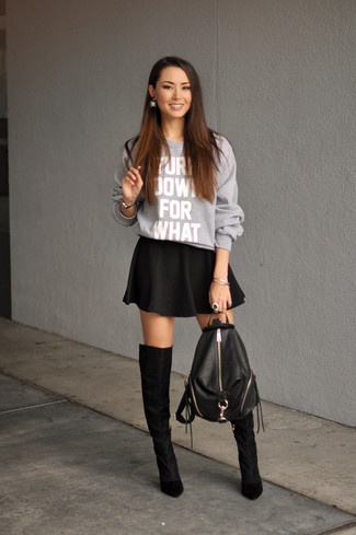 Something as simple as opting for a grey print oversized sweater and a black skater skirt can potentially set you apart from the crowd. Black suede over the knee boots will add elegance to an otherwise simple look. If you're already bored of your transitional weather fashion options, this ensemble just might be the inspiration you are searching for.