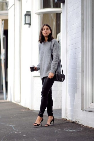 Consider wearing a grey oversized sweater and black leather skinny jeans for a casual get-up. Why not introduce black leather heeled sandals to the mix for an added touch of style?