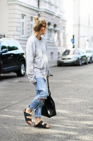 Consider wearing an oversized sweater and light blue distressed boyfriend jeans for a casual get-up. A pair of black leather flat sandals will seamlessly integrate within a variety of outfits.