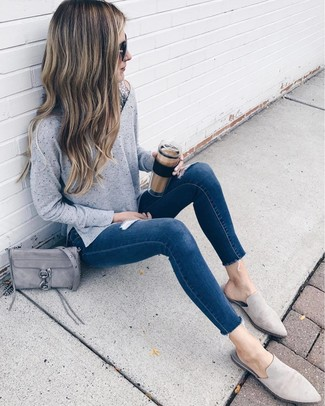 How to Wear Grey Suede Loafers For Women: A grey oversized sweater and navy ripped skinny jeans are must-have casual items, without which our wardrobes would definitely be incomplete. You could perhaps get a bit experimental on the shoe front and dress up your ensemble by slipping into grey suede loafers.