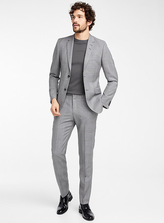 How to Wear a Grey Crew-neck Sweater For Men: Try teaming a grey crew-neck sweater with a grey plaid suit for a sleek polished ensemble. Amp up the wow factor of this outfit by sporting a pair of black leather derby shoes.