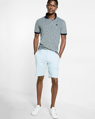How to wear: grey polo, light blue shorts, white low top sneakers