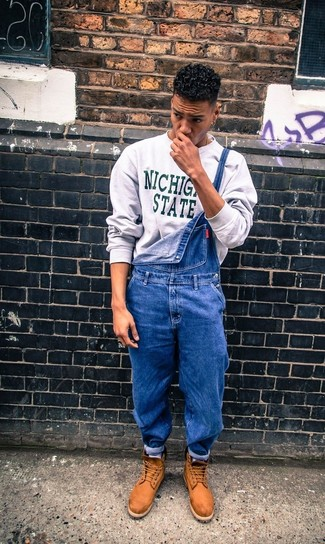 For an everyday outfit that is full of character and personality opt for a grey print crew-neck pullover and blue denim dungarees. Take a classic approach with the footwear and rock a pair of khaki leather boots.