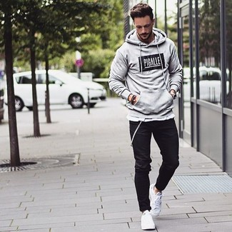 The versatility of a grey graphic hoodie and black chinos makes them  investment-worthy pieces