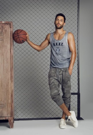 How to wear: grey print tank, grey camouflage sweatpants, white low top sneakers