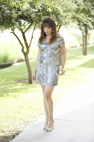 Show off your sophisticated side in a grey sequin sheath dress. Round off this look with gold leather pumps.