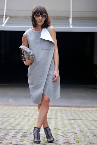 Tap into refined, elegant style with a grey shift dress. For the maximum chicness grab a pair of grey suede booties.