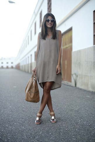 Go for a sophisticated look in a grey silk shift dress. Silver leather heeled sandals are a wonderful choice to complete the look.