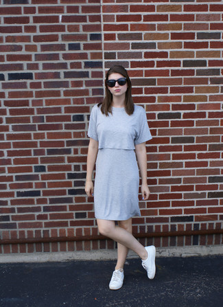 How to wear: grey shift dress, white low top sneakers, black sunglasses