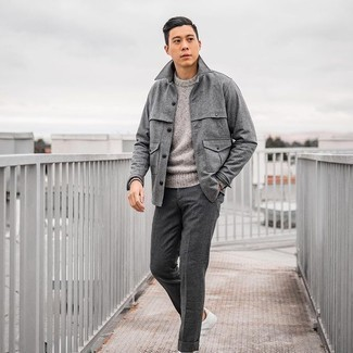 Grey Crew-neck Sweater Outfits For Men: Marrying a grey crew-neck sweater and charcoal wool dress pants is a surefire way to inject a sophisticated touch into your wardrobe. Inject a dose of stylish casualness into your look with a pair of white leather low top sneakers.