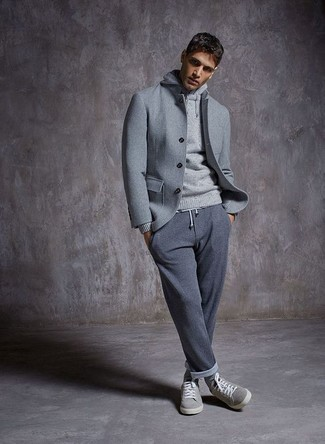 How to wear: grey wool shirt jacket, grey hoodie, grey sweatpants, grey suede low top sneakers