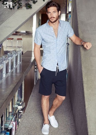 How to Wear White Canvas Slip-on Sneakers For Men: This outfit with a grey polka dot short sleeve shirt and navy shorts isn't a hard one to assemble and is easy to adapt. Our favorite of a countless number of ways to finish this ensemble is white canvas slip-on sneakers.