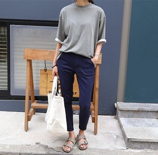 How to Wear Grey Leather Flat Sandals: Why not consider wearing a grey short sleeve sweater and navy chinos? As well as super practical, these items look amazing paired together. Grey leather flat sandals add a more laid-back aesthetic to the look.