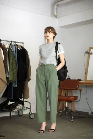 This combination of a grey short sleeve sweater and army green wide leg pants is so easy to achieve and so comfortable to wear all day long as well! Kick up the cool of your look by wearing black suede heeled sandals. Clearly, it's easier to work through a warm weather day in a summery ensemble such as this one.