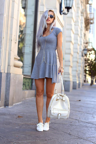 How to wear: grey skater dress, white canvas low top sneakers, white leather backpack