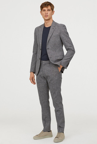 How to wear: grey suit, black crew-neck t-shirt, beige suede low top sneakers, black socks