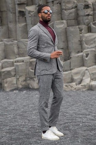 Consider wearing a grey wool suit and a burgundy turtleneck for a sharp, fashionable look. Mix things up by wearing white leather low top sneakers. It goes without saying that this one makes for a great, spring-ready combination.