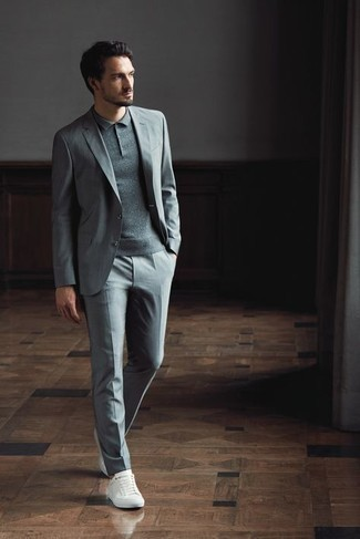 1200+ Warm Weather Outfits For Men: This smart casual combination of a grey suit and a grey polo takes on different forms according to the way it's styled. For a more relaxed vibe, add a pair of white canvas low top sneakers to this outfit.