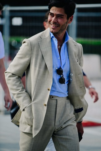 How to wear: grey suit, light blue polo, black sunglasses
