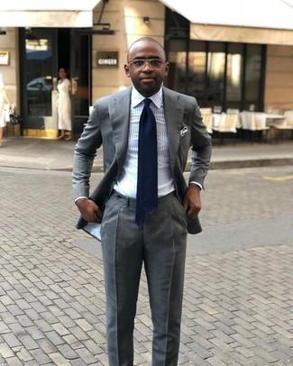 How to wear: grey suit, light blue vertical striped dress shirt, navy tie