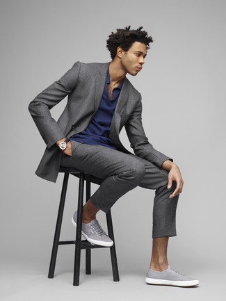 How to wear: grey suit, navy polo, grey canvas low top sneakers, black leather watch