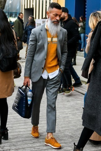 How To Wear a Long Sleeve Shirt With a Suit: Go for something smart yet current with a suit and a long sleeve shirt. For a more casual take, complement your look with a pair of orange low top sneakers.