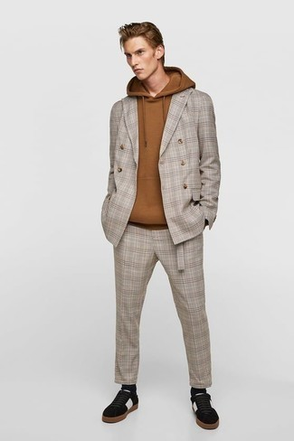Grey Plaid Suit Outfits: Marrying a grey plaid suit with a tan hoodie is an amazing choice for an effortlessly classic getup. Make your getup more functional by finishing off with a pair of black and white suede low top sneakers.