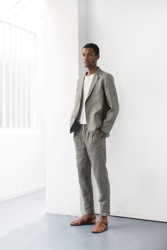 How to Wear a Grey Suit: A grey suit and a white crew-neck t-shirt are the kind of a no-brainer combo that you need when you have zero time. Why not introduce brown leather sandals to this look for an element of stylish casualness?