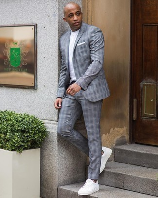 Sneakers Outfits For Men: For an ensemble that's nothing less than wow-worthy, pair a grey plaid suit with a white crew-neck t-shirt. For something more on the casual and cool end to complete this getup, introduce a pair of sneakers to the equation.