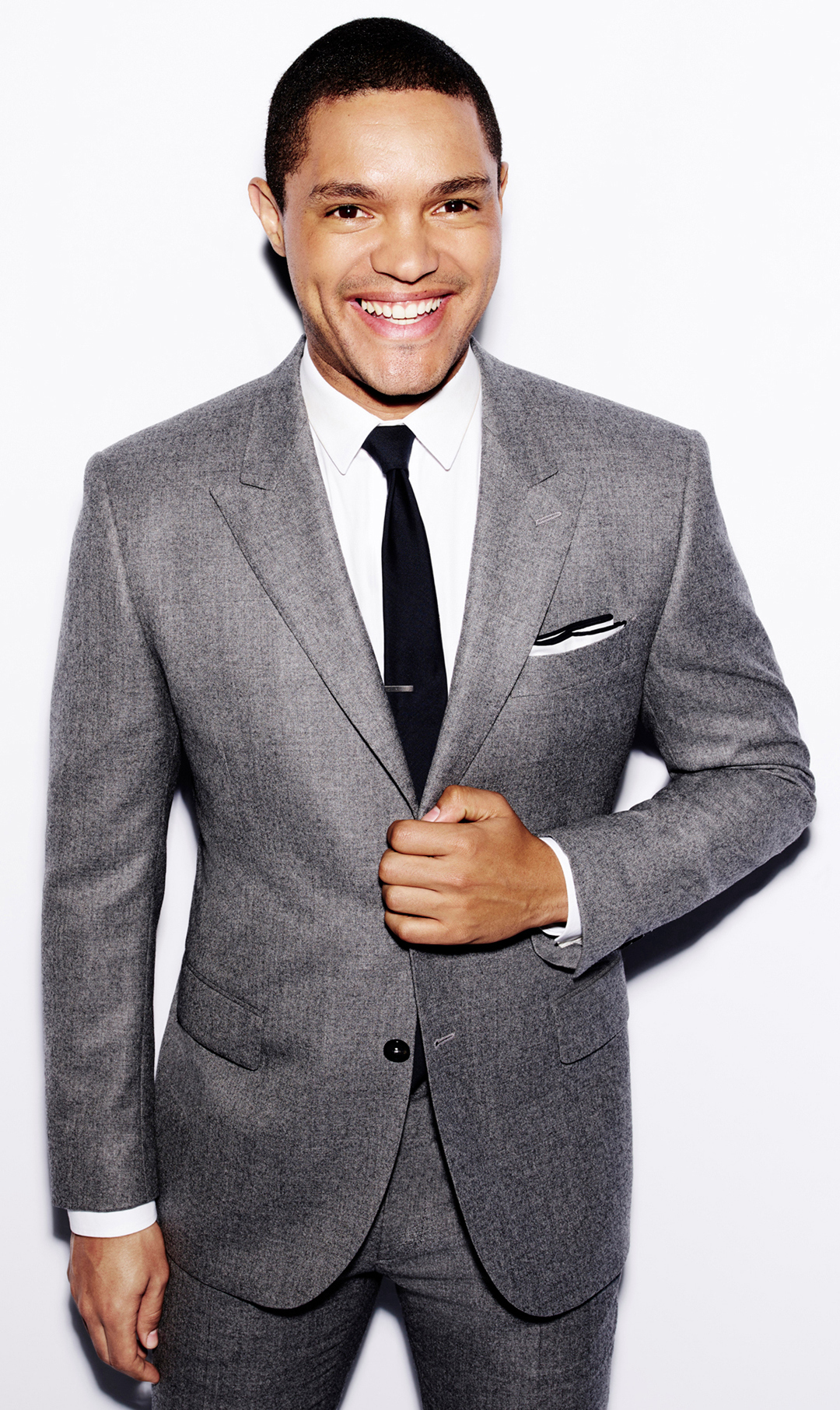 Trevor Noah wearing Grey Suit, White Dress Shirt, Black Tie, White