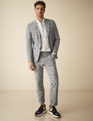 How to Wear Multi colored Athletic Shoes For Men: Channel your inner expert in modern men's style and wear a grey suit and a white dress shirt. Complement this look with multi colored athletic shoes to make a classic ensemble feel suddenly fun and fresh.
