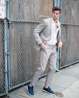 How to wear: grey suit, white print long sleeve shirt, navy leather low top sneakers