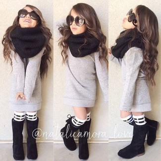 How to wear: grey sweater, black boots, black scarf, white and black horizontal striped socks