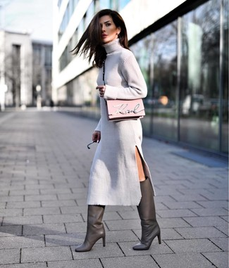 How to Wear Leather Knee High Boots: If you're seeking to take your casual look up a notch, choose a grey sweater dress. For maximum effect, add leather knee high boots to the mix.
