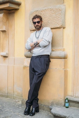 How to Wear a Grey Sweatshirt After 40 For Men: Team a grey sweatshirt with black chinos to put together a casual and cool look. A pair of black leather chelsea boots will bring a different twist to an otherwise simple outfit.