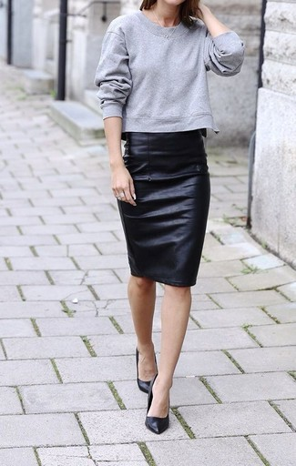 Try teaming a grey sweatshirt with a black leather pencil skirt for a refined yet off-duty ensemble. For footwear go down the classic route with black leather pumps.
