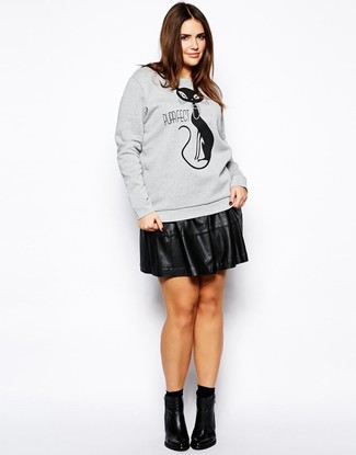 How to wear: grey print sweatshirt, black leather skater skirt, black leather ankle boots, black socks