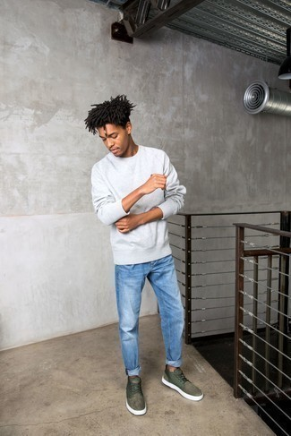 Grey Sweatshirt Outfits For Men: This off-duty combo of a grey sweatshirt and blue jeans is a safe bet when you need to look laid-back and cool but have no extra time to spare. We're totally digging how this whole outfit comes together thanks to olive suede low top sneakers.
