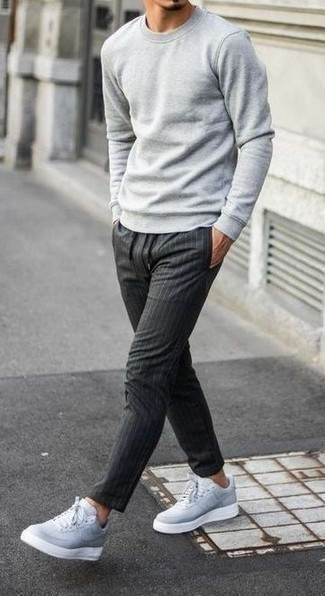 Grey Sweatshirt Outfits For Men: Who said you can't make a style statement with a casual look? Make ladies go weak in the knees in a grey sweatshirt and charcoal vertical striped chinos. A pair of grey leather low top sneakers will be a welcome addition for this getup.