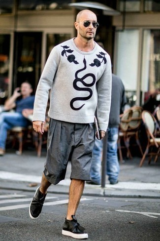 How to Wear a Grey Sweatshirt After 40 For Men: You'll be surprised at how extremely easy it is for any gent to pull together this casual outfit. Just a grey sweatshirt paired with grey shorts. A pair of black leather slip-on sneakers looks great complementing your ensemble.