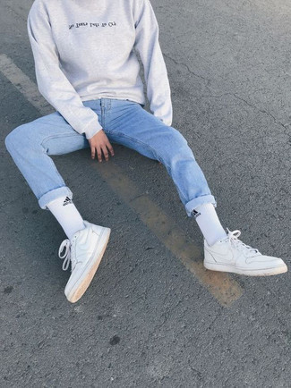 White and Red Leather Low Top Sneakers Outfits For Men: If you're a fan of laid-back looks, why not try teaming a grey print sweatshirt with light blue jeans? Complement this look with a pair of white and red leather low top sneakers et voila, this ensemble is complete.
