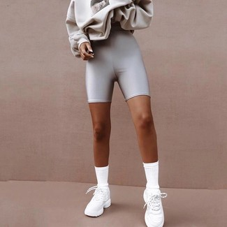 How to wear: grey print sweatshirt, silver bike shorts, white athletic shoes, white socks