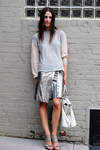 How to wear: grey sweatshirt, silver leather mini skirt, grey leather heeled sandals, white leather tote bag