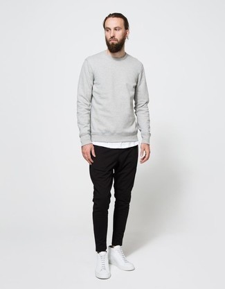 How to Wear White Leather High Top Sneakers In Your 30s For Men: If you're looking for an off-duty but also stylish outfit, try pairing a grey sweatshirt with black chinos. When it comes to shoes, go for something on the laid-back end of the spectrum with a pair of white leather high top sneakers.