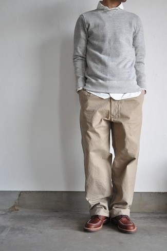 How to Wear a Grey Sweatshirt In Your 30s For Men: Showcase your skills in menswear styling by wearing this casual combo of a grey sweatshirt and khaki chinos. Get a little creative on the shoe front and complete your look with a pair of brown leather derby shoes.