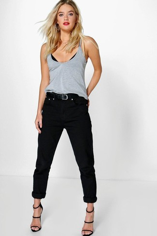 Make a grey tank and black boyfriend jeans your outfit choice if you're after an outfit idea for when you want to look casually cool. Up the cool of your outfit by rounding it off with black leather heeled sandals. So if you're on the hunt for an insta-worthy outfit on a hot afternoon, this just might be it.