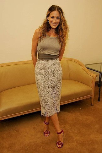 Consider pairing an Isabel Marant Maik Tank Top with a white lace midi skirt for a comfortable outfit that's also put together nicely. Dress up your ensemble with red suede heeled sandals. As we all know, the trick to getting through the hottest time of year is opting for fresh looks like this one.