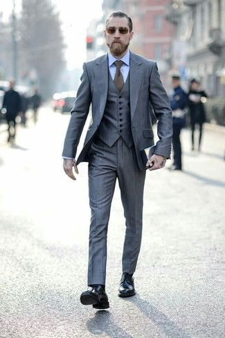 A modern man's sophisticated closet should always include such stylish essentials as a grey three piece suit and an olive tie. Make your getup more fun by finishing off with black leather dress boots. With rising temperatures come warmer afternoons and balmy nights and the need for a kick-ass outfit just like this one.